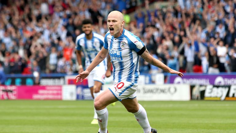 Aaron Mooy of Huddersfield Town celebrates scoring his sides first goal during the Premier League match between Huddersfield