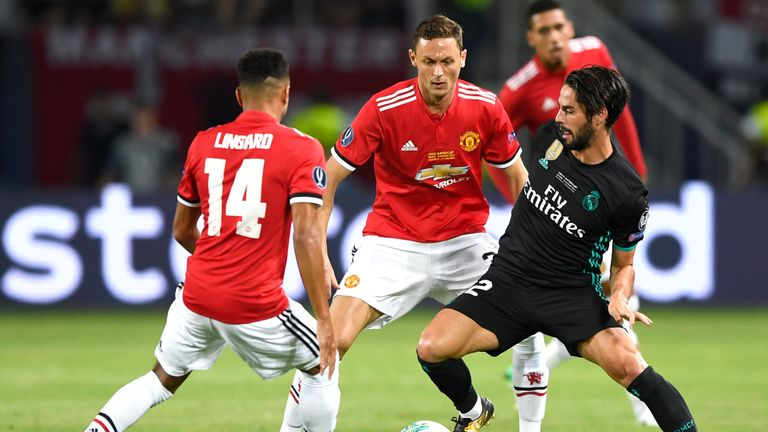 Nemanja Matic (centre) in action for  his new club in the UEFA Super Cup against Real Madrid