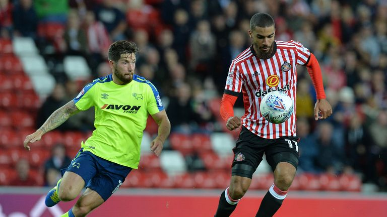 SUNDERLAND, ENGLAND - AUGUST 04: Lewis Grabban (R), of Sunderland takes on Jacob Butterfield of Derby County during the Sky Bet Championship match between