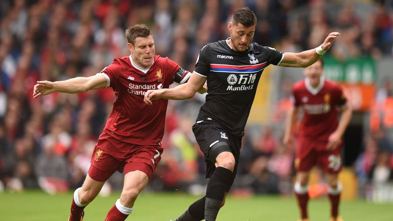 James Milner vies with Crystal Palace defender Joel Ward
