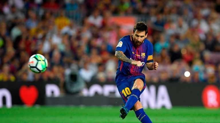 Barcelona's Argentinian forward Lionel Messi kicks the ball during the Spanish league footbal match FC Barcelona vs Real Betis at the Camp Nou stadium in B