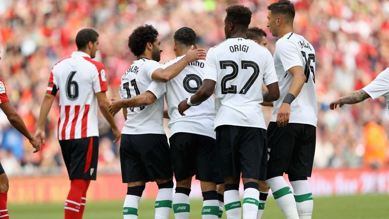 Liverpool's players celebrates after taking the lead in Dublin
