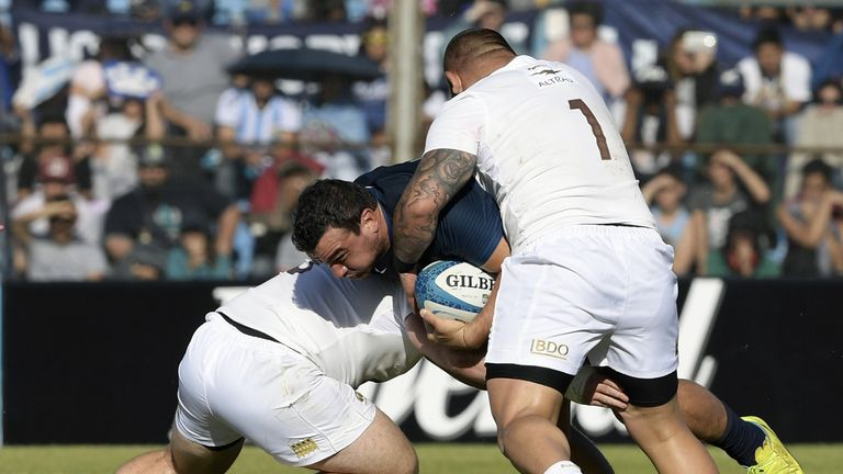 Argentina's hooker Agustin Creevy (C) barges over for a try against Georgia