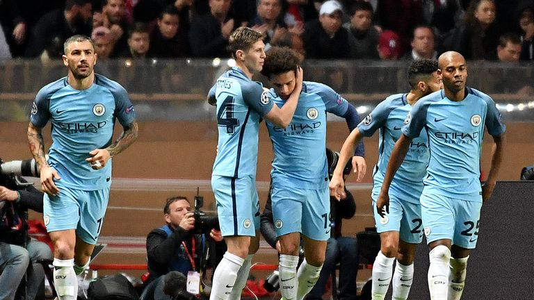 Manchester City's German midfielder Leroy Sane (C) celebrates with teammates after scoring a goal during the UEFA Champions League round of 16 match