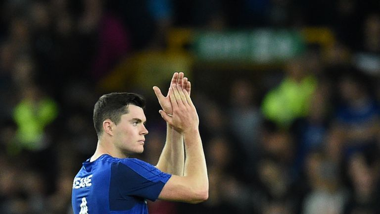 Everton's English defender Michael Keane applauds supporters after the UEFA Europa League playoff round, first leg football match between Everton and Hajdu