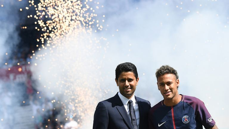 Neymar poses with PSG president Nasser Al-Khelaifi during his presentation to fans at Parc des Princes on August 5, 2017