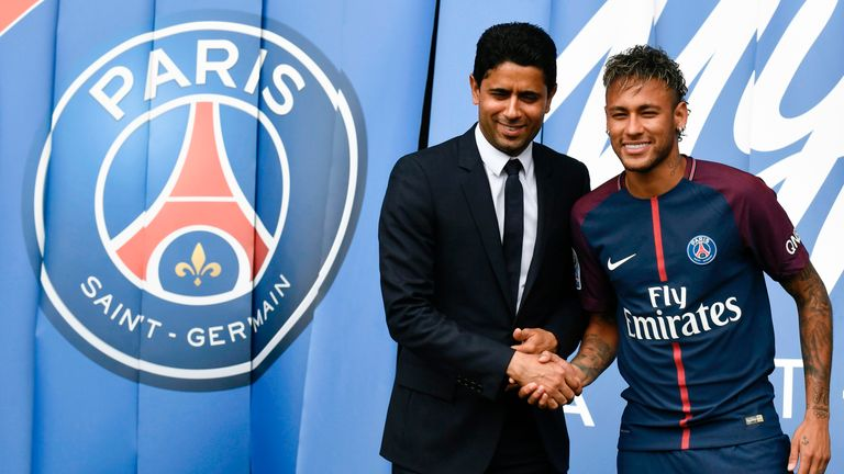 Neymar shakes hands with PSG president Nasser Al-Khelaifi following his world record £200m transfer from Barcelona