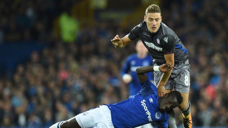 Idrissa Gueye battles with Nikola Vlasic during the UEFA Europa League playoff round, first leg match at Goodison Park