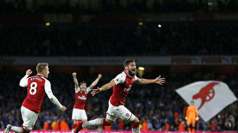 Substitute Olivier Giroud celebrates as Arsenal take a 4-3 lead at the Emirates Stadium