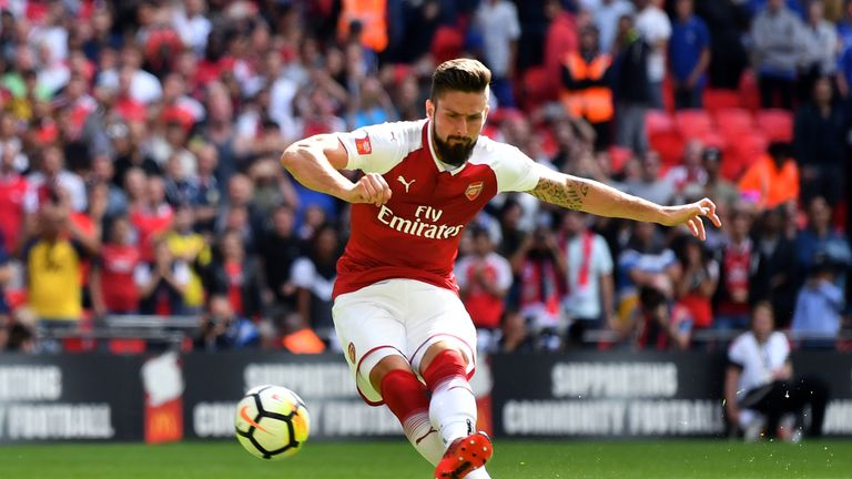 LONDON, ENGLAND - AUGUST 06: Olivier Giroud of Arsenal scores his sides fourth penalty in the penalty shoot out during the The FA Community Shield final be