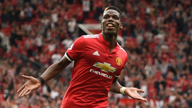 Manchester United's French midfielder Paul Pogba celebrates after scoring their fourth goal during the English Premier League football match between Manche