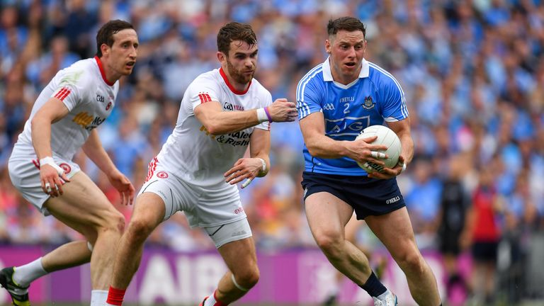 Philip McMahon of Dublin against Ronan McNamee, centre, and Colm Cavanagh of Tyrone