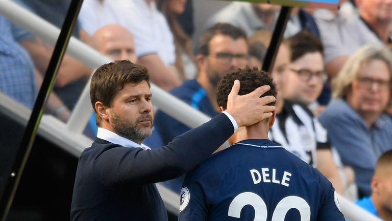 Dele Alli embraces with Mauricio Pochettino