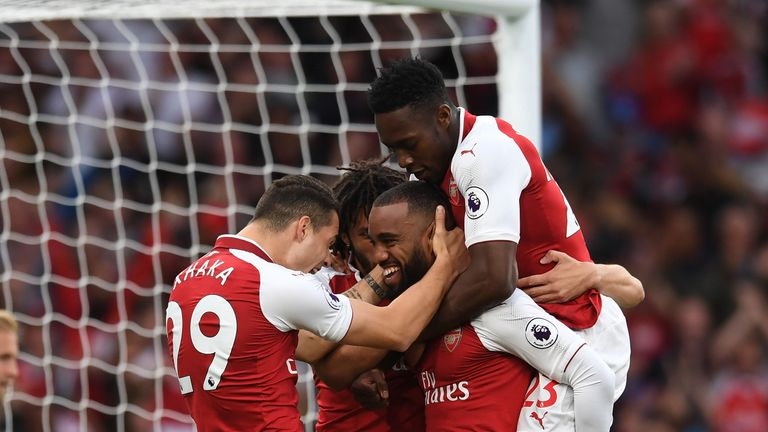 Alexandre Lacazette is congratulated by team-mates after scoring the opening goal of the game