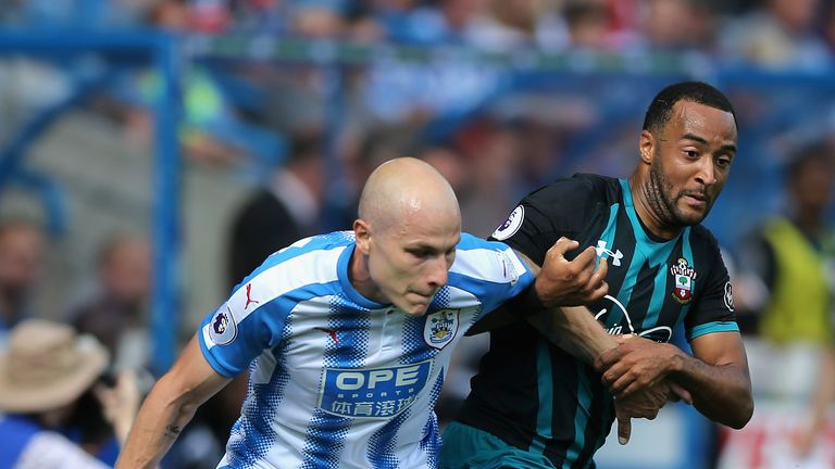 Aaron Mooy and Nathan Redmond in action at the John Smith's Stadium