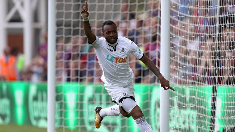 Jordan Ayew celebrates after doubling Swansea City's lead