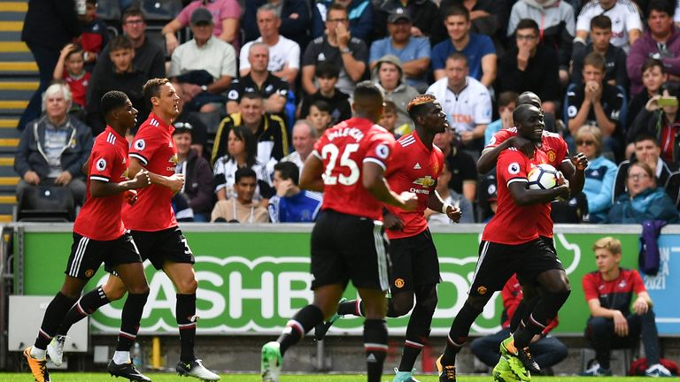 Eric Bailly celebrates his goal late in the first half at the Liberty Stadium