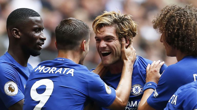 Marcos Alonso is congratulated by his Chelsea team-mates after opening the scoring at Wembley
