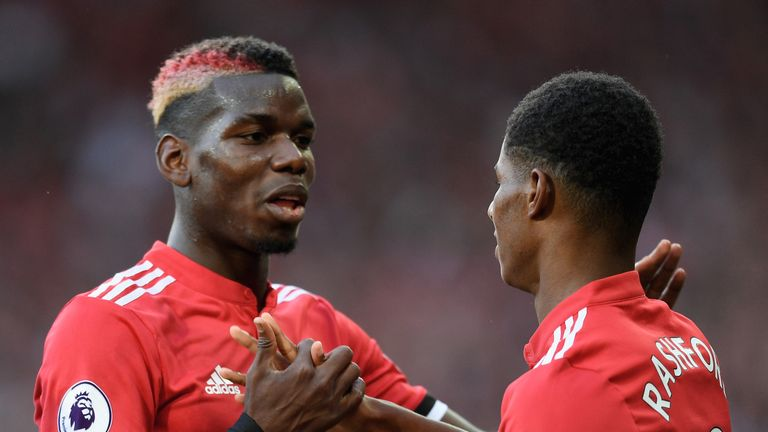 Marcus Rashford (R) celebrates his goal against Leicester with Paul Pogba (L)