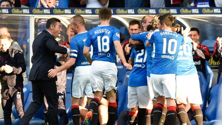 Rangers boss Pedro Caixinha (left) leads the celebrations after Bruno Alves' goal