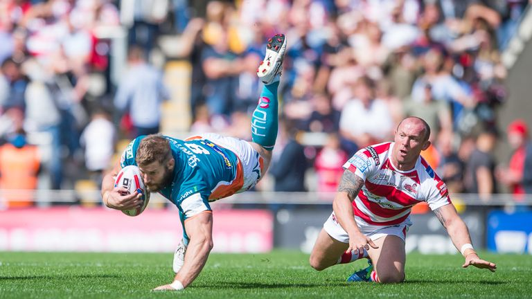 Nick Scruton is tripped up by Leigh hooker Mickey Higham
