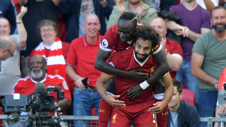 Liverpool's Egyptian midfielder Mohamed Salah (R) celebrates with Liverpool's Senegalese midfielder Sadio Mane after scoring their third goal during the En