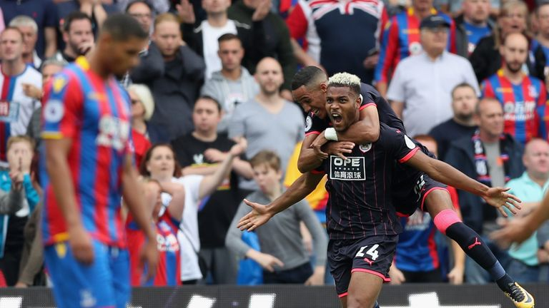 LONDON, ENGLAND - AUGUST 12:  Steve Mounie of Huddersfield Town celebrates scoring his sides second goal during the Premier League match between Crystal Pa