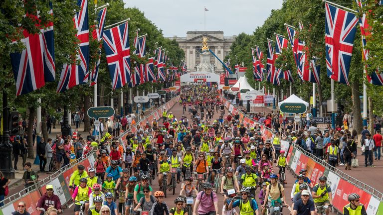 Riders cycle up The Mall, as part of the FreeCycle Prudential RideLondon
