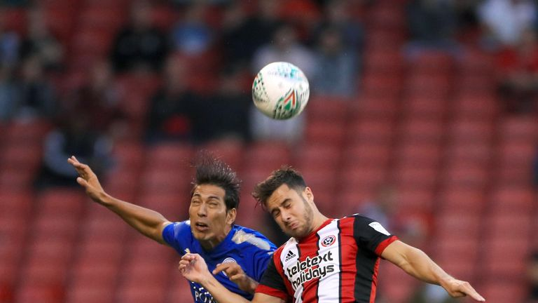 Leonardo Ulloa (left) and George Baldock battle for the ball