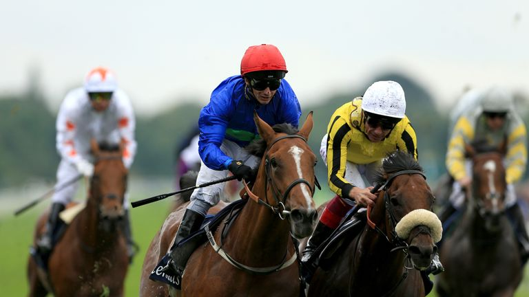 Wells Farhh Go ridden by David Allan (left) before winning the Tattersalls Acomb Stakes ahead of James Garfield ridden by Frankie Dettori during Juddmonte