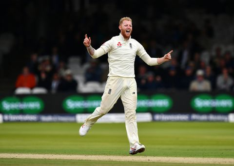 Ben Stokes of England celebrates taking the wicket of Jason Holder