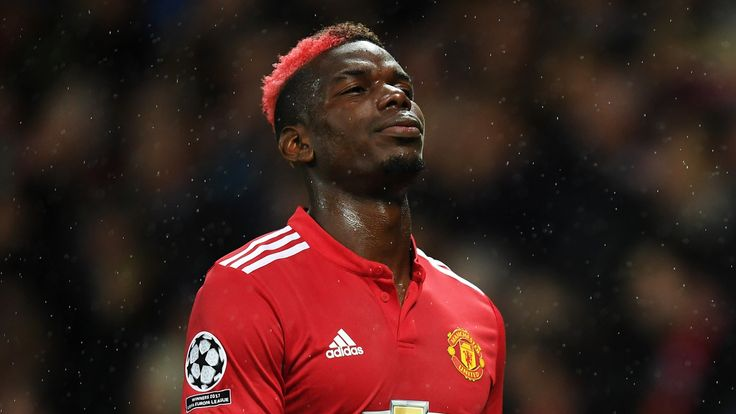 Paul Pogba of ManchesterUnited reacts to being forced off through injury during the UEFA Champions League Group A match