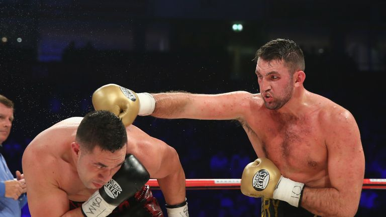 MANCHESTER, ENGLAND - SEPTEMBER 23:  Hughie Fury lands a right shot on Joseph Parker during the WBO World Heavyweight Title fight at Manchester Arena on Se