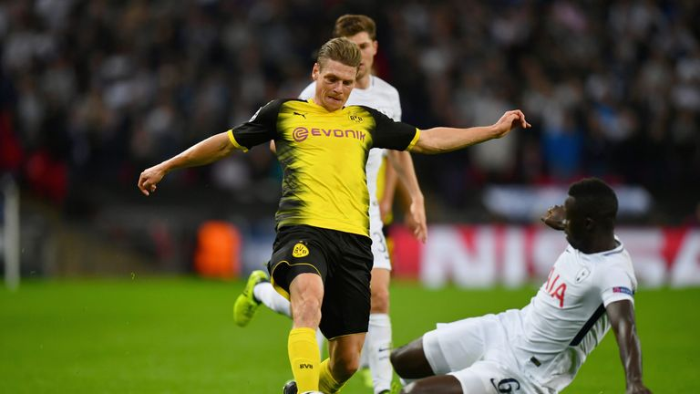 Lukasz Piszczek of Borussia Dortmund is tackled by Davinson Sanchez of Tottenham Hotspur during a UEFA Champions League game at Wembley in September 2017