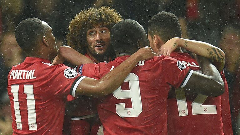 Marouane Fellaini celebrates with team-mates after scoring Manchester United's opening goal in their 3-0 UEFA Champions League Group A win over Basel