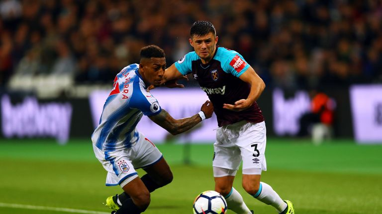 Aaron Cresswell of West Ham United and Rajiv van La Parra of Huddersfield Town battle for the ball during the Premier Leag