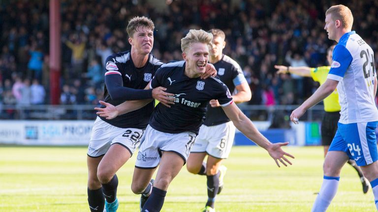 Dundee's A-Jay Leitch-Smith (centre) celebrates his goal.to make it 2-0 against St Johnstone last week.