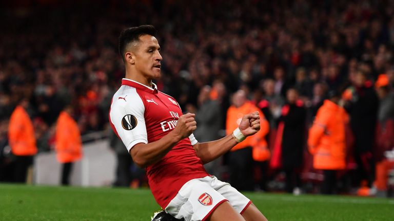 Alexis Sanchez celebrates his stunning goal to put Arsenal 2-1 up against Cologne