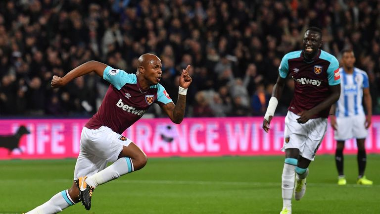 West Ham United's French-born Ghanaian midfielder Andre Ayew (L) celebrates after scoring their second goal during the English Premier League football matc