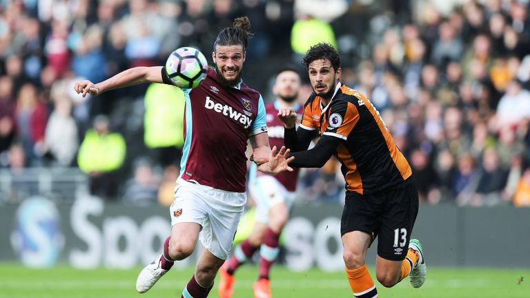 Andy Carroll and Andrea Ranocchia battle for possession during the Premier League match between Hull City and West Ham United on April 1, 2017