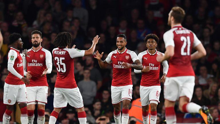 Theo Walcott celebrating his goal for Arsenal against Doncaster
