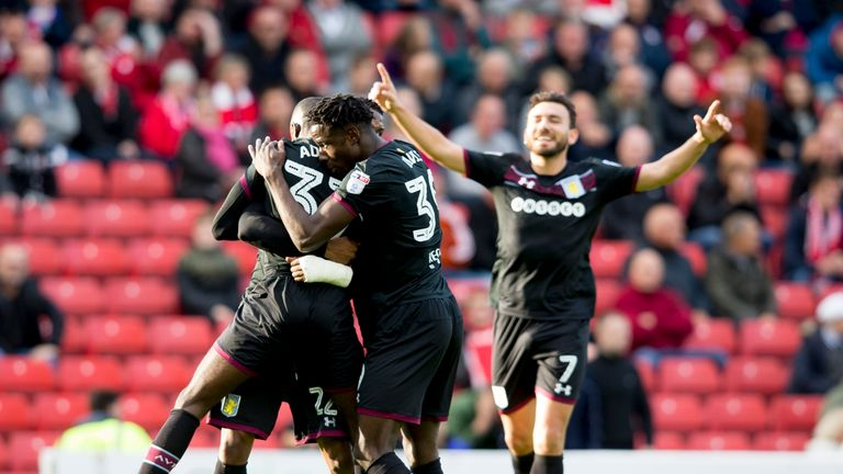 Albert Adomah celebrates with Aston Villa team-mates after scoring at Oakwell