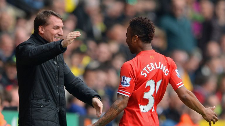 Brendan Rodgers celebrates with Raheem Sterling at Liverpool