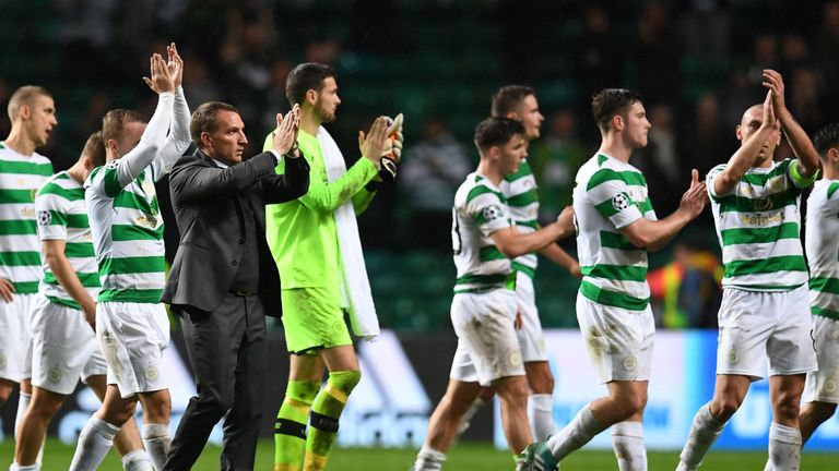 Rodgers and his players applaud the Celtic supporters
