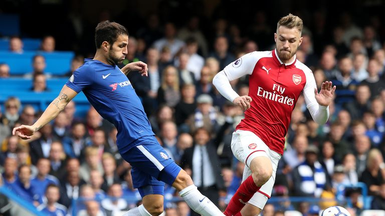 Chelsea's Cesc Fabregas (left) and Arsenal's Aaron Ramsey battle for the ball during the Premier League match at Stamford Bridge, London.