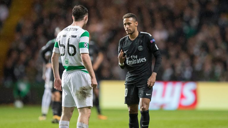 PSG's Neymar raises three fingers to Celtic's Anthony Ralston to remind him of the current score