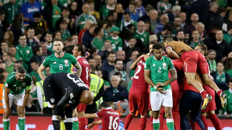 Cyrus Christie of the Republic of Ireland looks dejected at the final whistle after defeat to Serbia in their World Cup Qualifier Group D clash in Dublin