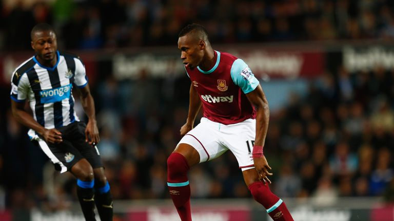 LONDON, ENGLAND - SEPTEMBER 14: Diafra Sakho of West Ham United is closed down by Chancel Mbemba of Newcastle United