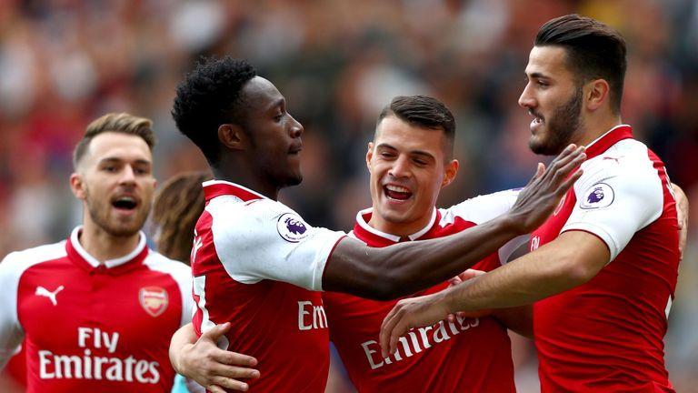 LONDON, ENGLAND - SEPTEMBER 09:  Danny Welbeck of Arsenal celebrates scoring his sides first goal with Granit Xhaka of Arsenal and Sead Kolasinac of Arsena