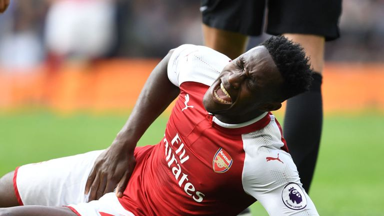 Injured Arsenal striker Danny Welbeck during the Premier League match between Chelsea and Arsenal at Stamford Bridge on September 17, 2017
